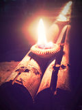 Flame light on small pottery candle base. Stock Photography