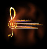 Flame and music. Abstract dark background and big golden treble clef in fire Royalty Free Stock Photo