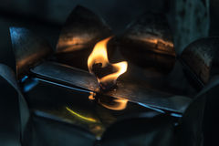 Flame of Oil Lamp in darkness Stock Image