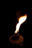 Flame from an oil lantern. Nighttime flame from an oil patio lantern Royalty Free Stock Photos