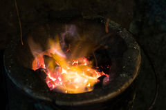 Flame in old charcoal stove. Royalty Free Stock Photography