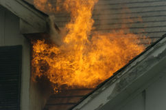 Flame over. Flame comming out of roof Stock Photography