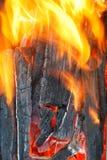 Flame over burning firewood Stock Photos