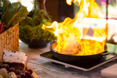 Flame in a pan. Royalty Free Stock Image