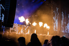 Flame projectors on a live EDM concert Royalty Free Stock Photo