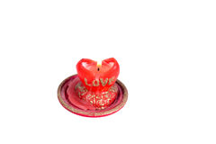 Flame red candles in the shape of a heart with the word love on Royalty Free Stock Images