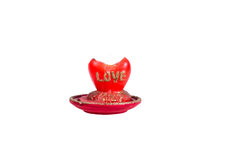 Flame red candles in the shape of a heart with the word love Royalty Free Stock Images