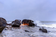 Flame on the sea Stock Images
