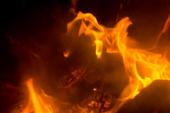 Flame with sparks. Fire flames on a black background Royalty Free Stock Photo