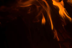 Flame with sparks. Fire flames on a black background Royalty Free Stock Images