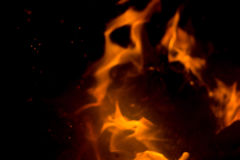 Flame with sparks. Fire flames on a black background Royalty Free Stock Image
