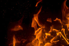 Flame with sparks. Fire flames on a black background Royalty Free Stock Photos
