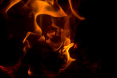 Flame with sparks. Fire flames on a black background Stock Images