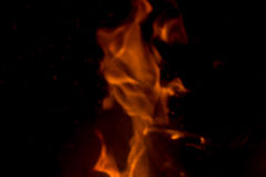 Flame with sparks. Fire flames on a black background Royalty Free Stock Photography