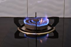 Flame on the stove. Black glass floor royalty free stock images