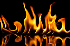 Flame texture on black background. Flame texture on black studio background royalty free stock images