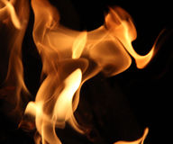 Flame tips on a black background Royalty Free Stock Images