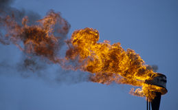 Flame torch. And blue sky - environment pollution. Ecology damage Stock Photos