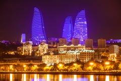Flame Towers in Baku. BAKU, AZERBAIJAN - SEPTEMBER 15, 2016: Baku Flame Towers at night. It is the tallest skyscraper in Baku, Azerbaijan with a height of 190 Stock Photos