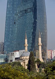 Flame Towers and a mosque in Baku Royalty Free Stock Photos