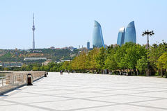 Flame Towers skyscrapers, TV tower and embankment of Caspian Sea. View of the Flame Towers skyscrapers and TV tower from the embankment of Caspian Sea in Baku royalty free stock photography