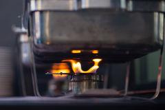 Flame under buffet warmer Stock Image