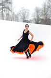 Flamenco. Attractive woman dancing flamenco, Against a snow-covered landscape Royalty Free Stock Photography