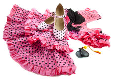Flamenco. Spanish dress and shoes isolated over white Stock Images