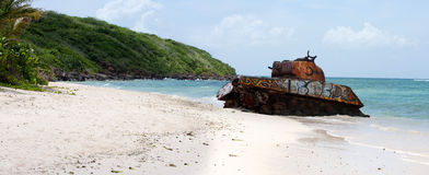 Flamenco Beach Army Tank. An old rusted and deserted army tank of Flamenco beach on the Puerto Rican island of Culebra. Paradise lost Royalty Free Stock Image