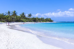 Flamenco Beach. CULEBRA, PUERTO RICO - JANUARY 21, 2014: Vacationers enjoy the clear blue water and warm sunshine on one of the world's best beaches, Flamenco