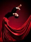 Flamenco Carmen beautiful woman. In dress on dark background Royalty Free Stock Photos
