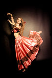 Flamenco dancer. In red clothes royalty free stock image
