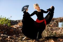 Flamenco dancer. Beautiful girl dances flamenco in outdoor Royalty Free Stock Image