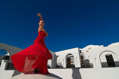 Flamenco dancer. Attractive flamenco dancer wearing traditional red dress with flower in her hair Stock Image