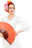 Flamenco dancer. Young attractive flamenco dancer with roses in her hair over white background Stock Photography