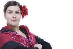 Flamenco dancer closeup portrait with rose. Young woman flamenco dancer portrait with red rose and gipsy wrap, isolated on white Stock Photography
