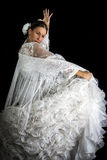 Flamenco dancer backs with white dress and hands crossed up. On black background royalty free stock photography