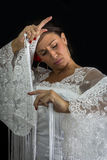 Flamenco dancer dressed in white with expression of feeling Royalty Free Stock Image