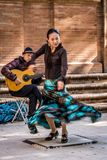 Flamenco dancer in motion and guitarist. The Flamenco dancer and her guitarist in Seville, Andalusia, Spain royalty free stock image