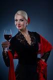 Flamenco dancer holding a glass of wine Royalty Free Stock Image