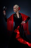 Flamenco dancer holding a glass of wine Royalty Free Stock Photo