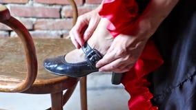 Flamenco dancer putting on shoe closeup stock video footage