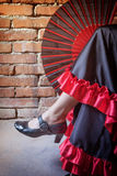 Flamenco dancer sitting with an open fan Royalty Free Stock Photography