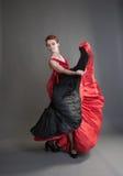 Flamenco. Dancer swinging skirt on a grey background Stock Images