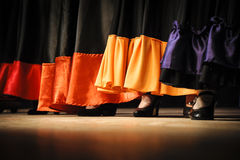 Flamenco. Dancers close-up skirts and shoes Stock Images