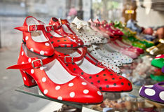 Flamenco dancing shoes or gypsy shoes in  Seville, Spain. Flamenco dancing shoes or gypsy shoes with polka dot spots in shop market, Seville, Spain Royalty Free Stock Images