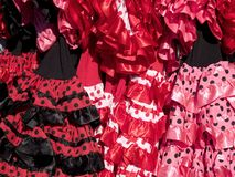 Flamenco dresses. At a street market on a sunny day royalty free stock images
