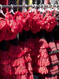 Flamenco dresses. At a street market on a sunny day royalty free stock photography