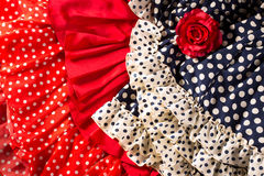 Flamenco dresses in red blue with spot and red rose Stock Photography