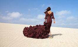 Flamenco in the dunes. Flamenco dancer in the long dress in the dunes Royalty Free Stock Photo